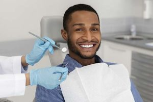 man learning about cosmetic dentistry services