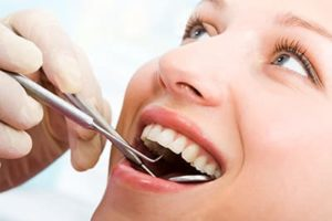 patient being checked for dental fillings and dental sealants